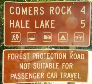 comers rock roadsign