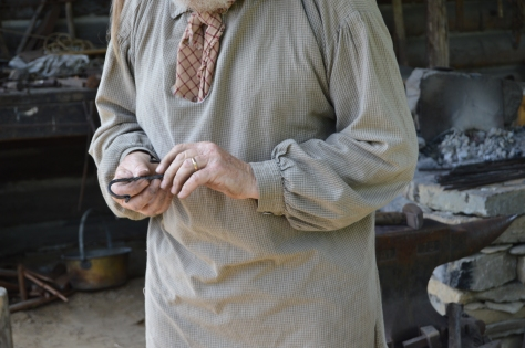 "The blacksmith showing the ""S"" hook he made during the video."