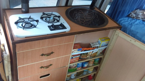 A little cupboard storage. The large panel below the drawers pops off to allow access to the propane from inside.